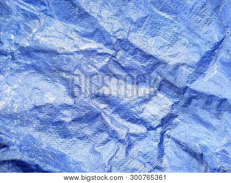 Wrinkly Blue Plastic Construction Tarp Abstract Horizontal Background Texture
