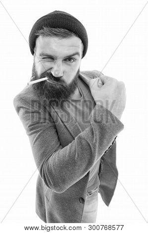 Man Brutal Bearded Hipster Bully Dressed As Vagabond Smoking Cigarette. Brutal Habits And Lifestyle.