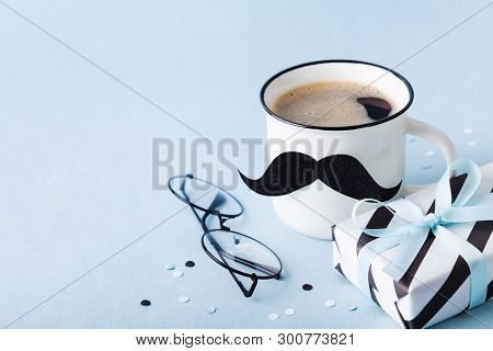 Creative Breakfast On Happy Fathers Day With Gift Or Present Box And Funny Face From Cup Of Coffee A