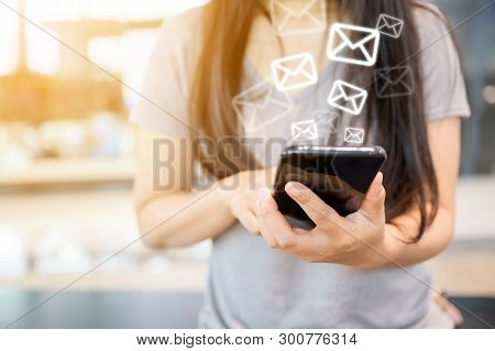 Close-up Image Of Female Hands Using Smartphone With Icon Envelope Email. Contact Us Customer Servic