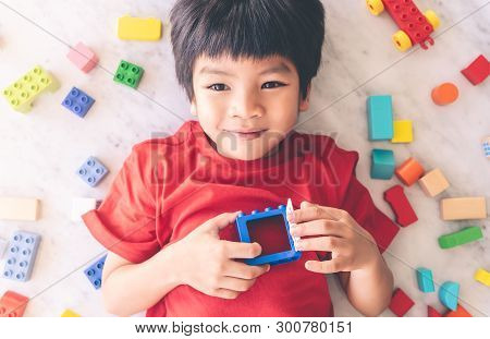 Happy Boy Surrounded By Colorful Toy Blocks With Open Heart Windows