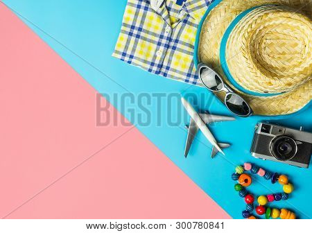Summer Travel Fashion And Accessories Travel Top View Flatlay On Blue Pink
