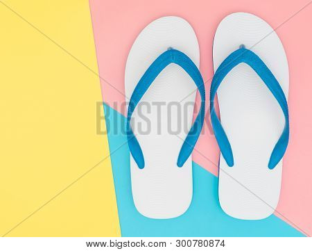 White Foam Beach Sandals On Yellow And Blue Pink Copy Space