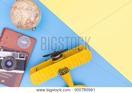 Vintage Travel Equipment Object On Blue Yellow Pink Copy Space