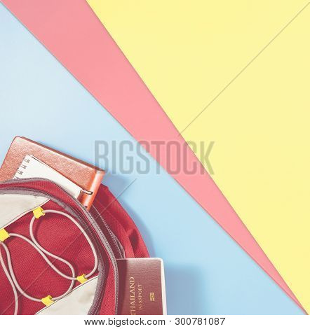 Traveler Backpack With Travel Accessories On Blue Yellow Pink Copy Space