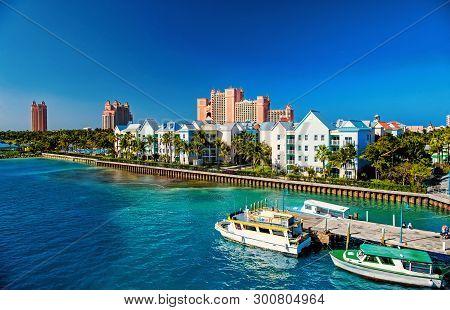 Resort Hotel Building Villa With Green Palm Tree Tropic Garden On Sea Beach On Sunny Day On Blue Sky