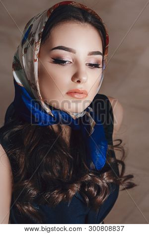 Portrait Of Beautiful Young Girl With Makeup  In Fashion Clothes. Stock Photo.