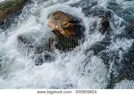 Big Boulders In Mountain Creek Close-up. Rapids Of Fast River With Copy Space. Foamed Water Stream.