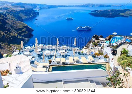 Oia, Cafe Tables With Caldera Sea View In Santorini Island With White And Blue Houses, Greece