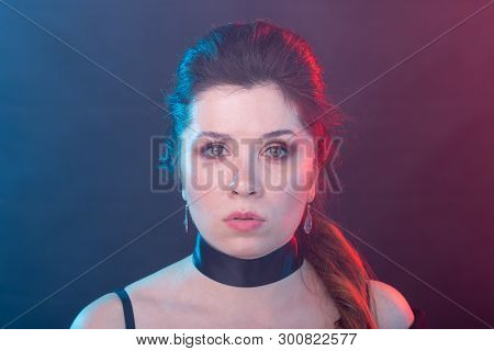 Gothic, fashion and people concept - charming woman in gothic makeup and choker poster