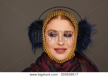 Creative portrait of an interesting woman in an unusual style using chaplet. Studio photo session. White background poster
