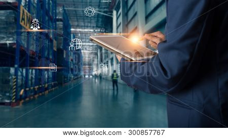 Business Logistics Concept, Businessman Manager Using Tablet Check And Control For Workers With Mode