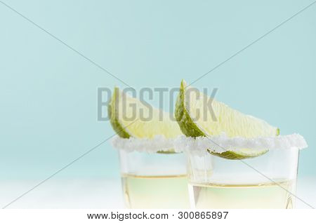 Tequila Shot Drinks With Green Lime, Salty Edge In Modern Pastel Green Color Background, Closeup, To