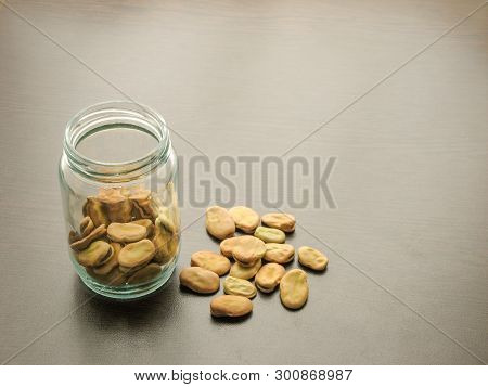 Broad Beans (vicia Faba) In A Glass Jar On The Wooden Table. Broad Beans  In A Glass Dish. Wooden Ba