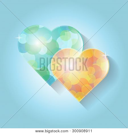 Two Glass Hearts In Yellow And Blue Tone