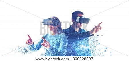 A Man And A Woman In Glasses Of Virtual Reality. The Concept Of Modern Technologies And Technologies