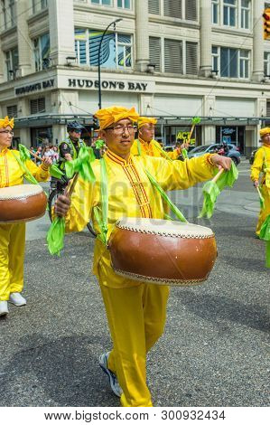 May 12, 2019 - Vancouver, Canada: Falun Dafa Members In Parade Through Streets Of Downtown On Mother