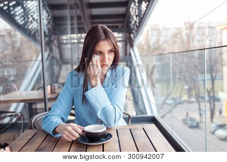 Misery, Infelicity. Brunette Woman Girl About To Cry Wiping Tears Sneezing In A Tissue Drinking Tea,