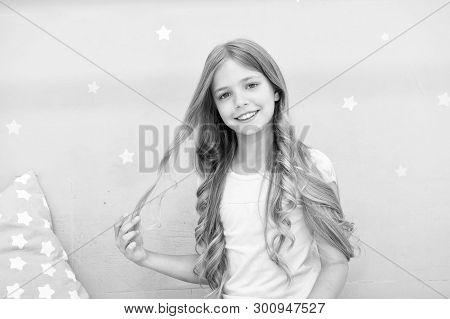 Good Morning. Girl Child Long Curly Hair Awake. Pleasant Awakening. Girl Looks Cheerfully And Full O