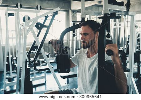 Handsome Man Is Exercising With Pectoral Machine In Fitness Club.,portrait Of Strong Man Doing Worki
