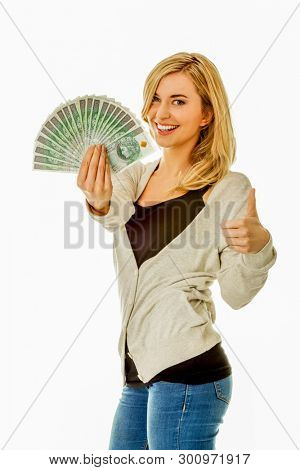 Young blond woman is holding fan with polish zlote money on white background.