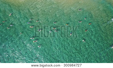 Aerial View Over The Turqoise Waters And Surfers At Byron Bay