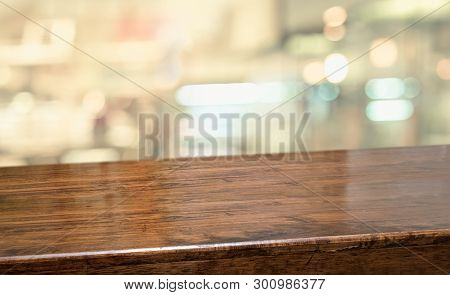 Wood Table At Restaurant Blur Background.empty Perspective Hardwood Bar With Blur Coffee Shop With B