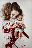 Halloween Theme Girl Child Zombie or Ghost covered in blood holding knife and baby doll. poster