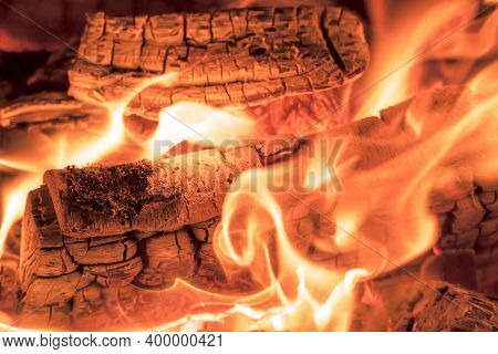 A Blazing Fire In The Dark. Inflammation Of Firewood In The Fire. A Bright Burning Flames. Sparks An
