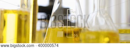 Flasks And Test Tubes Contain Yellow Liquid. Experiments And Research In Field Of Pharmaceuticals Co