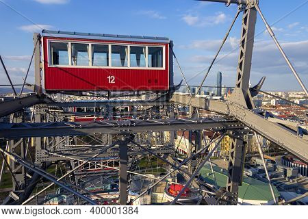 Wien Or Vein. Sunset Panorama Of Vienna From Famous Prater Riesenrad, Old Giant Ferris Wheel And Fam
