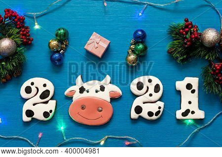 Gingerbread Gingerbread In The Form Of Numbers 2021 And The Symbol Of The New Year Bull On A Blue Wo