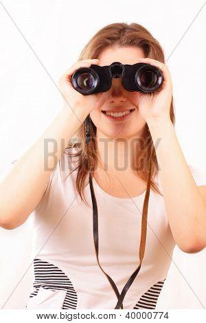 Attractive Young Girl Looking Through Binoculars