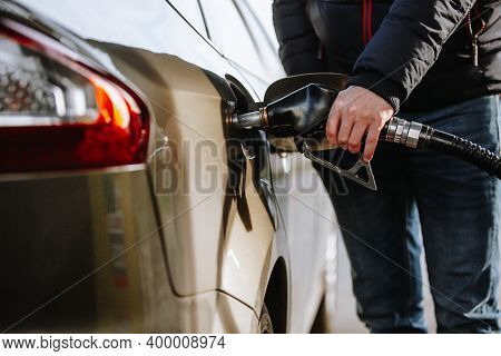 Man Refueling His Car In The Gas Or Filling Station By Naphtha Or Oil Fuel, Fueling Process