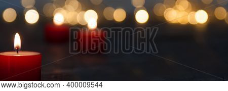 Christmas Candle Light With Blurred Golden Bokeh For Religious Ritual And Funeral Service Or Spiritu