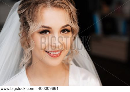 Portrait Of The Bride Gathered In The Studio Of Beauty, A Beautiful Blonde With Hair And Makeup In A
