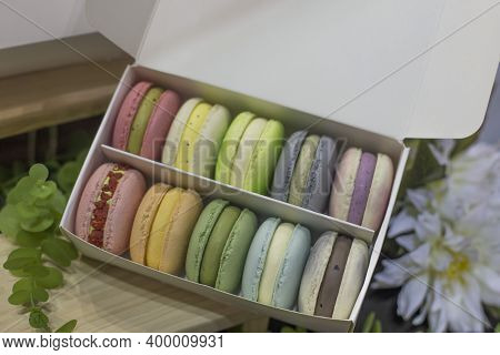 Colorful French Macaroons In A Gift Box.