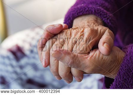 Close-up Of Wrinkly Hands Of An Elderly Woman. Concept Of Aged People And Healthcare.