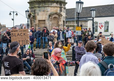 Richmond, North Yorkshire, Uk - June 14, 2020: A Group Of Black Lives Matter Protesters Stand Off Ag