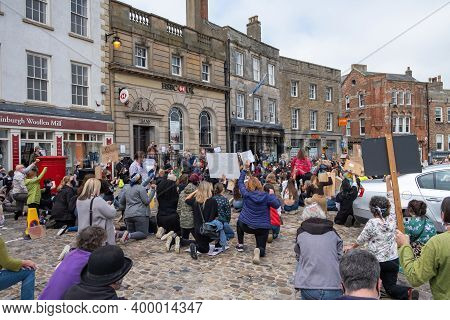Richmond, North Yorkshire, Uk - June 14, 2020: A Group Of Protesters Kneel In The Street At A Black