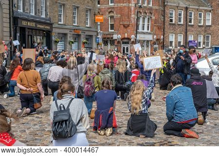 Richmond, North Yorkshire, Uk - June 14, 2020: A Group Of Black Lives Matter Protesters Kneel In The
