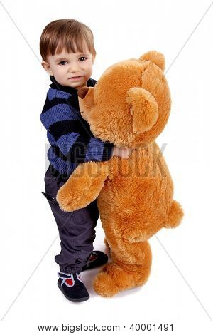 Little boy holding a teddy bear
