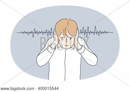 Noise, Loudness Concept. Young Irritated Stressed Boy Covering Ears With Hands Feeling Impossible To