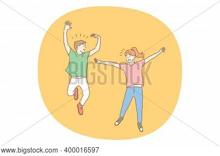 Jumping Children, Childhood, Fun Concept. Happy Boy And Girl Brother Sister Kids Or Friends Jumping