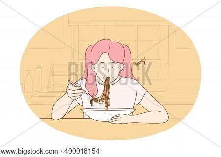 Eating Yummy Homemade Food. Positive Hungry Girl Sitting Eating Spaghetti Pasta Noodles With Sauce F