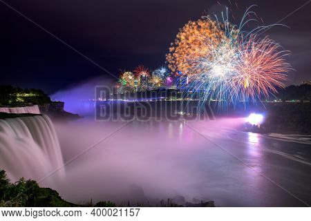 Night View On Colorful Fireworks In Niagara Falls In Holydays