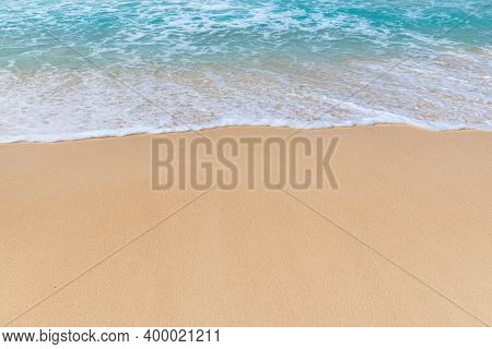 Sunny White Sand Beach And Turquoise Sea. Summer Vacation And Tropical Beach Background.