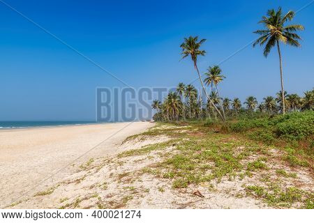 Tropical Beach. Sandy Beach With Palm And Turquoise Sea In Goa, India. Summer Vacation And Tropical