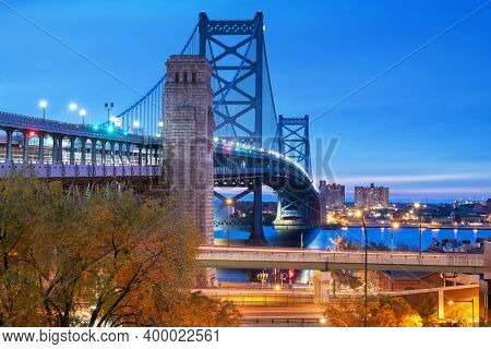 Philadelphia, Pennsylvania, USA at Benjamin Franklin Bridge spanning the Delaware River towards Camden New Jersey.
