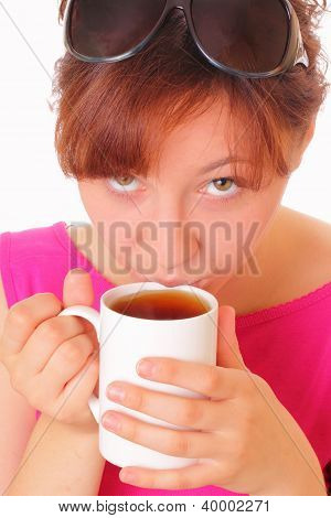 Beautiful Young Girl Drinking A Cup Of Aromatic Tea